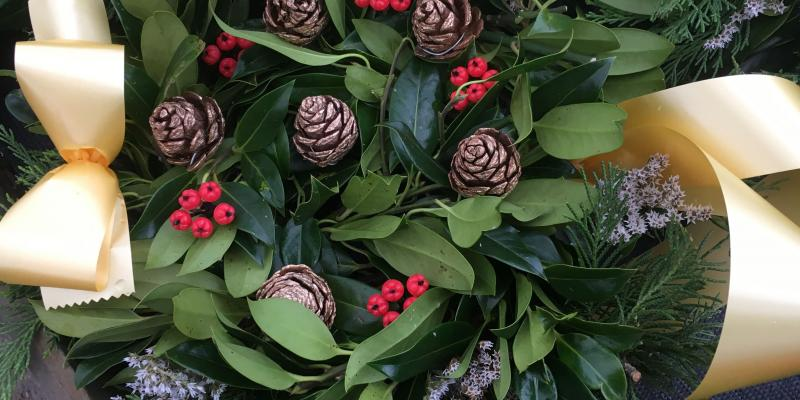 fresh holly wreath berries cones pink sprigs gold ribbon